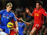 LONDON, ENGLAND - NOVEMBER 11:  Fernando Torres of Chelsea holds off the challenge of Jamie Carragher of Liverpool during the Barclays Premier League match between Chelsea and Liverpool at Stamford Bridge on November 11, 2012 in London, England.  (Photo by Mike Hewitt/Getty Images)
