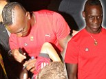 Balotelli is mobbed by Liverpool fans after medical at Anfield