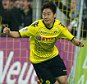 epa04373731 (FILES) A file picture dated 30 March 2012 of Shinji Kagawa of Borussia Dortmund celebrating after scoring the opening goal during the German Bundesliga soccer match between Borussia Dortmund and VfB Stuttgart in Dortmund, Germany. Bundesliga club Borussia Dortmund are close to re-signing Japan midfielder Shinji Kagawa after he had two mostly unsuccessful years at Manchester United. Talks between the clubs are in an advanced stage, according to German and British news reports 29 August 2014.  EPA/BERND THISSEN