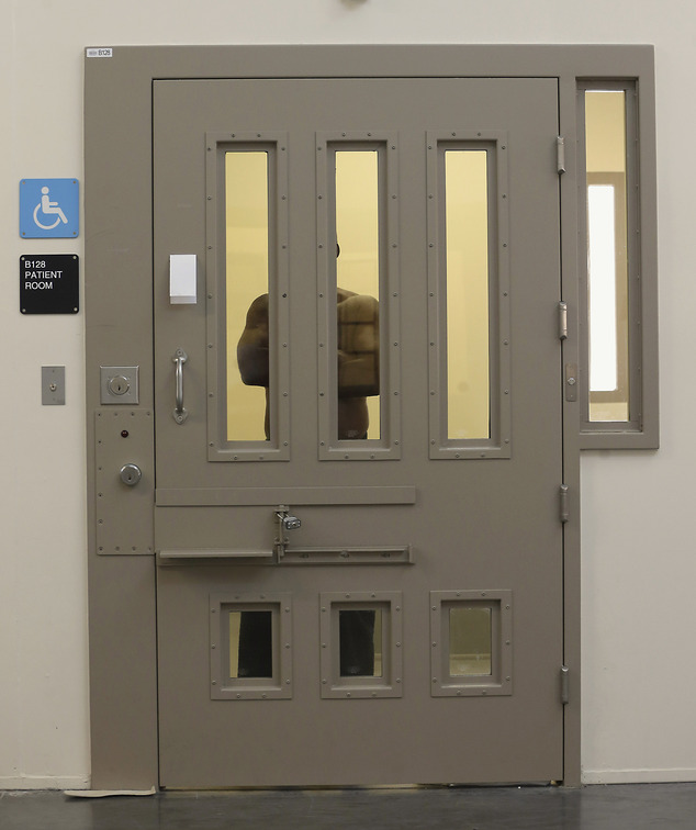 FILE --  In this July 24, 2014 file photo,  an inmate is seen in one of the cells at the mental health unit at the California Department of Corrections and R...