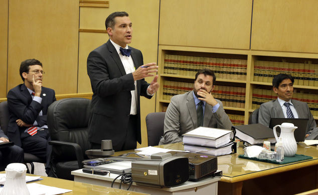 Mark Nelson, second from left, speaks as he stands in Pierce County Superior Court, Friday, Aug. 29, 2014, in Tacoma, Wash. Nelson represents a man who wants...