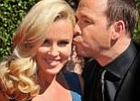 Kisses: Donnie plants a peck on his fiancé's head