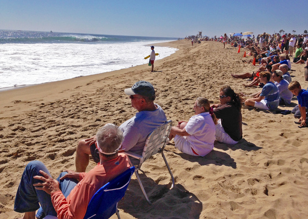 CORRECTS BYLINE TO GILLIAN FLACCUS, NOT NICK UT - Watching from a safe distance behind a barricade of traffic cones, beachgoers watch huge waves crash onto t...