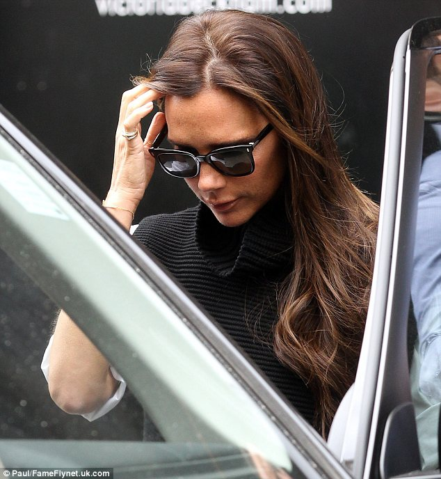 City slicker: The star looked great with her brunette hair in soft waves and a pair of designer sunglasses completing her look