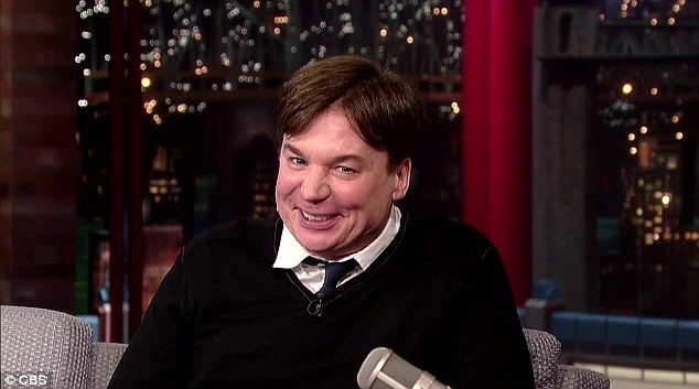 Family album time: Mike Myers was the picture of pride and joy as he shared snaps of his little boy Spike and baby girl Sunday during Thursday's appearance on The Late Show With David Letterman