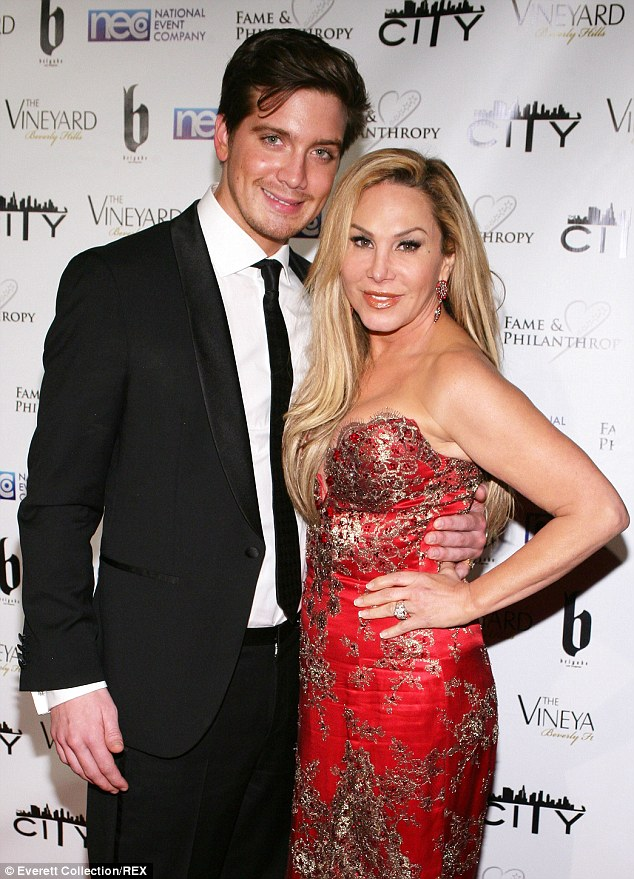 Taking the plunge? Adrienne was pictured with toyboy Jacob Busch, 25, at an Oscars event in March