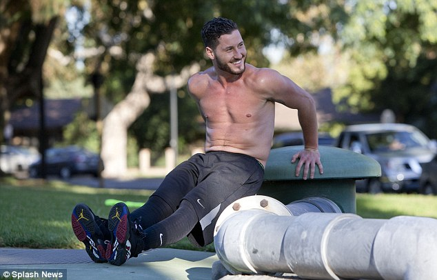 How's that for a warm-up: Val smilingly plopped down to do some muscle-building tricep dips