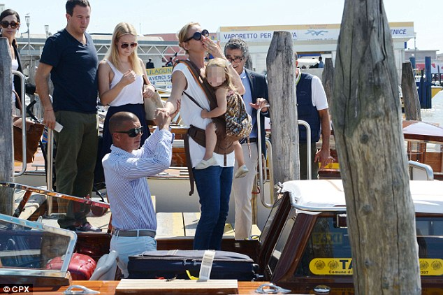 All aboard: The family then hopped on a taxi boat to navigate the city's waterways