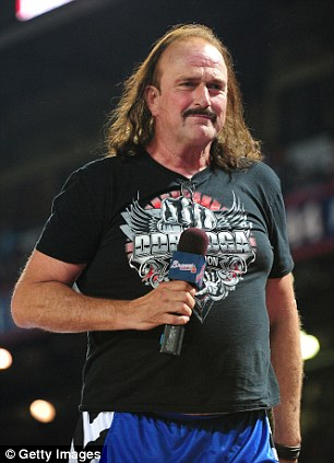 """ATLANTA, GA - MAY 17: Former professional wrestler Jake """"The Snake"""" Roberts sings during the seventh inning stretch of the game between the Los Angeles Dodgers and the Atlanta Braves at Turner Field on May 17, 2013 in Atlanta, Georgia. (Photo by Scott Cunningham/Getty Images)"""