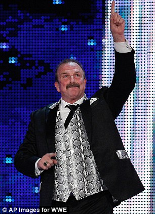 """Jake """"The Snake"""" Roberts speaks during the WWE Hall of Fame Induction at the Smoothie King Center in New Orleans on Saturday, April 5, 2014. (Jonathan Bachman/AP Images for WWE)"""
