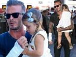 David Beckham sports bandaged arm after motorbike crash as he carries daughter Harper to a departing flight