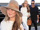 Opposites attract! Chrissy Teigen is chic in neutral summery ensemble as she jets out of LA with husband John Legend who rocks cool all-black look