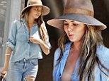 All of her: Chrissy Teigen, 28, nearly exposed her chest on Wednesday when her top came unbuttoned. The wife of John Legend was out with one of the couple's three dogs when the wardrobe malfunction occurred
