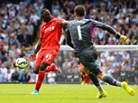 LONDON, ENGLAND - AUGUST 31:  Mario Balotelli of Liverpool shoots at an open goal past Hugo Lloris of Spurs during the Barclays Premier League match between Tottenham Hotspur and Liverpool at White Hart Lane on August 31, 2014 in London, England.  (Photo by Jamie McDonald/Getty Images)