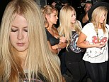 Avril Lavigne held on tightly to her friends as she left Chateau Marmont
