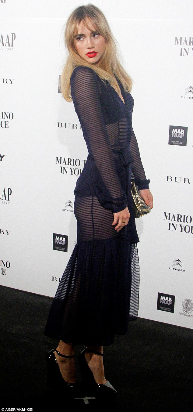 Sheer beauty: Suki Waterhouse turned heads when she attended a Burbery-sponsored gala for celebrity photographer Mario Testino's In Your Face exhibition in Sao Paolo, Brazil, on Thursday night