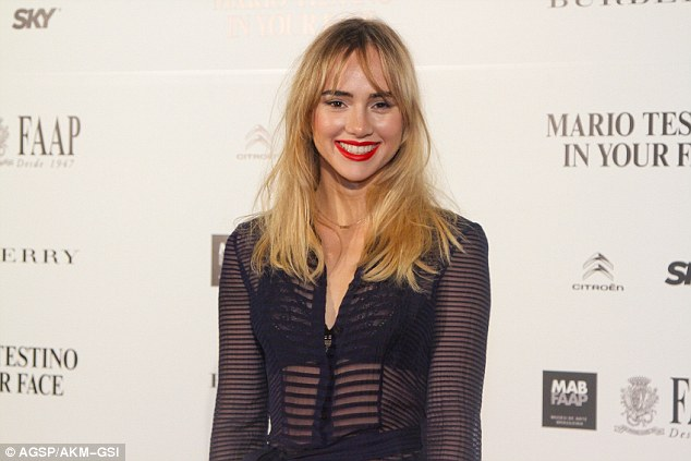 Bra-vo! The British beauty showed off her cleavage and lacy bra in the plunging semi-sheer Burbery dress