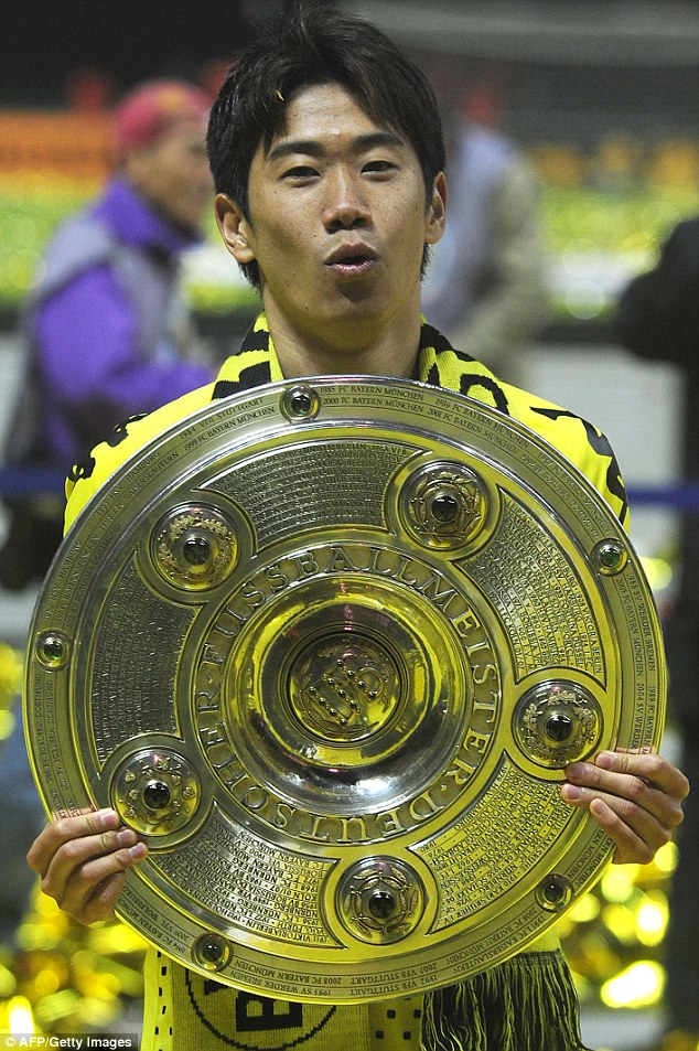 German success: Kagawa holds the German cup after Dortmund's victory against Bayern Munich  in 2012