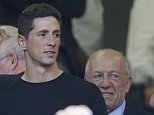 AC Milan forward Fernando Torres of Spain watches from the stands during a Serie A soccer match between AC Milan and Lazio, at the San Siro stadium in Milan, Italy, Sunday, Aug. 31, 2014. (AP Photo/Luca Bruno)