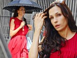 X-Men actress Famke Janssen is determined to keep her youthful complexion for as long as she can. The 48-year-old New Yorker was seen going to and from a Manhattan gym protecting herself from the harmful UV rays of the sun with a black umbrella