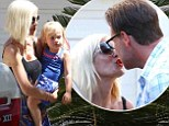 The family that celebrates together... Tori Spelling and Dean McDermott share a kiss at their son Finn's birthday party