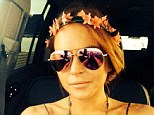 Golden girl: Lindsay Lohan posted a selfie while sitting in a car in London and posting it to Twitter, the 28-year-old wrote: 'Still have my @brazilbronze glow even in LDN. #bronzeperfection'