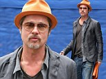 The honeymoon is over! Brad Pitt gets back to work in New York after brief romantic holiday with Angelina Jolie