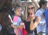 Hands on mom! Denise Richards shows her unwavering support for her daughter, Lola, as she competes in the LA Equestrian competition on Sunday