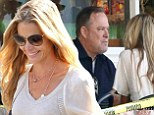 Denise Richards rocks ripped jeans for coffee with mystery man at Beverly Glen Deli