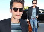 John Mayer cuts a trimmer figure as his jeans appear to be falling down while arriving at LAX