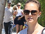 Out with her boys! A casually-dressed Natalie Portman carries sleepy son Aleph while out for a stroll with husband Benjamin Millepied in LA