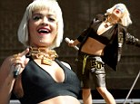 Cream of the crop! Rita Ora shows off her toned midriff in plunging crop top on the second day of Made In America festival