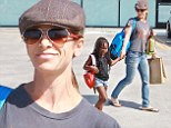 Doting mother Jillian Michaels walks hand-in-hand with daughter Lukensia while running errands together in Malibu