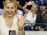 Tennis fan: Kelly Rutherford took in the US Open on Saturday with her brother after losing an international custody battle earlier this month over her two children
