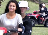 Revving up their relationship! Justin Bieber and Selena Gomez snuggle up close as they ride an ATV together in Canada
