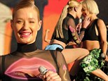 Iggy Azalea and Rita Ora tease fans with an almost kiss as they lead performances at the Budweiser Made In America Festival