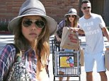 Playing the part: Jessica Alba and her husband Cash Warren put on a mischievous act as they left Ralphs Supermarket in Malibu, California on Saturday