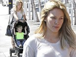 Hilary Duff shows off her muscular legs in ripped denim shorts as she spends quality time with son Luca after announcing album delay
