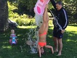 'Carmen lent us her bathtub': Bikini-clad Hilaria Baldwin does the ALS Ice Bucket Challenge while doing a handstand