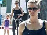 Bun in the oven: Amanda Peet paraded her baby bump while grocery shopping at Bristol Farms in West Hollywood with her seven-year-old daughter Frances Pen Benioff on Saturday