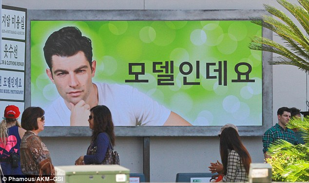 What's next? A billboard featuring Max's character hinted at what was in store for the roommate