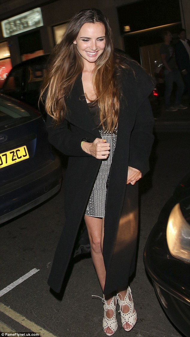 Radiant: Nadine Coyle was all smiles as she left the Groucho Club in London on Thursday night