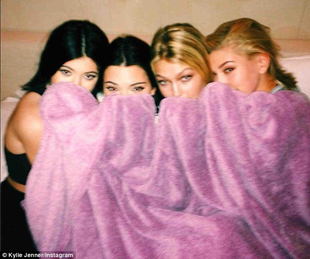 Peek-a-boo: Kylie and her pals are in the mood for fun in another fun snap