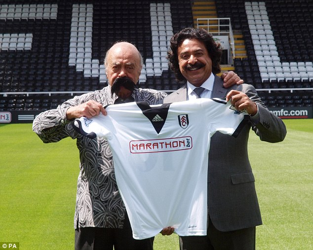 Changing hands: Shahid Khan (right) bought Fulham from Mohamed Al Fayed (left) in 2013