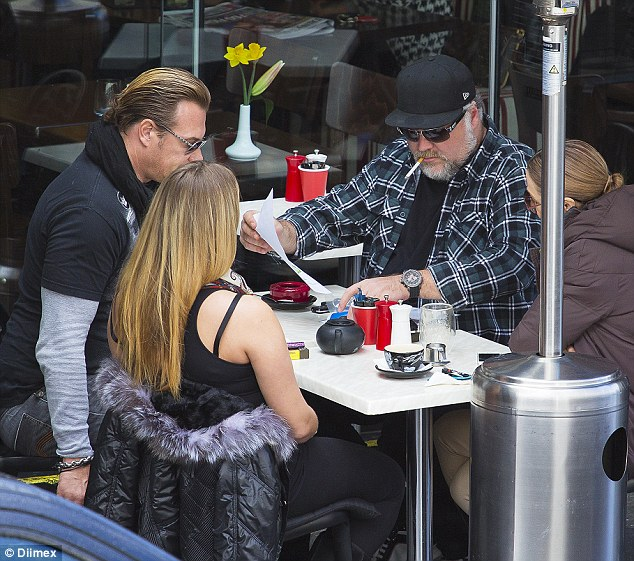 Large and in charge! Kyle Sandilands was spotted during a meeting on Friday in Sydney