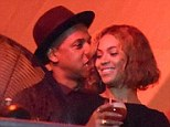 Sweet nothings: The hip hop mogul whispered in his famous wife's ear