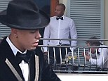 Dutch courage? Evan Ross and groomsmen Eric Johnson and Donald Faison knock back drinks and smoke something suspicious before he weds Ashlee Simpson