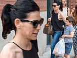 Helping hand: Julianna Margulies's six-year-old son Kieran Lieberthal held onto a heaving bag of groceries as he and his petite mom headed home in New York City on Monday