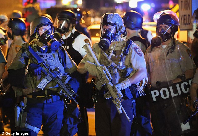 Police in Ferguson (not those pictured) are being sued for £40million over claims that they used 'excessive force' and brutality