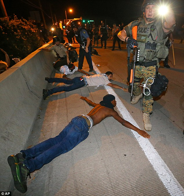 Police begin arresting dozens of protesters in Ferguson on August 20 after they refused to leave the area
